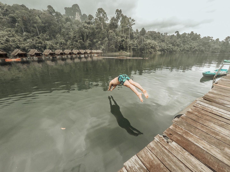 Paul diving into the lake at Praiwan Raft House
