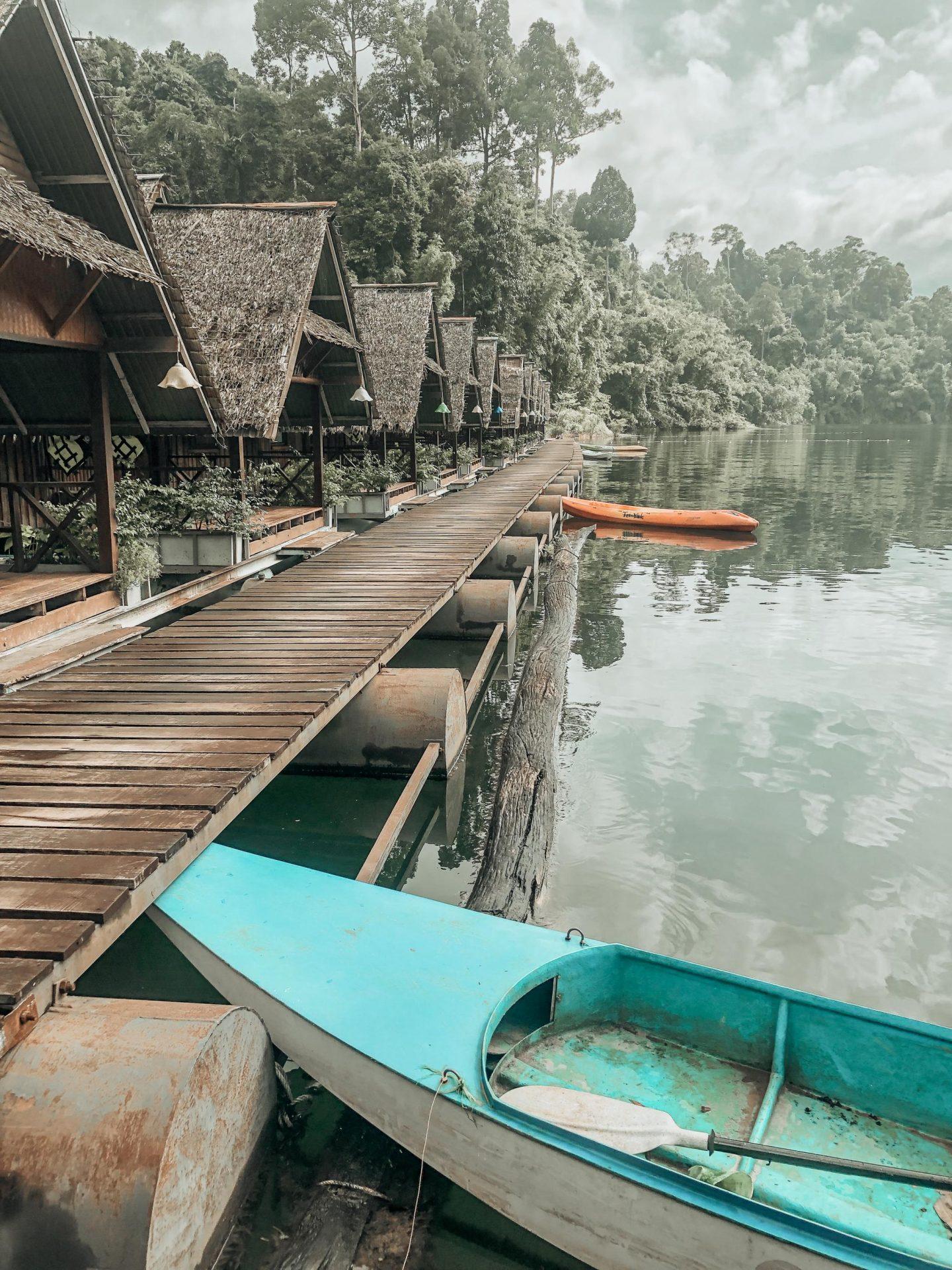 Moored kayaks at Praiwan Raft House on Cheow Lan Lake